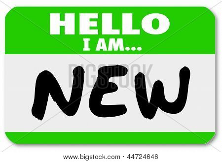 A green nametag sticker with the words Hello I Am New for a rookie, trainee, new staff hire, newbie, beginner or apprentice