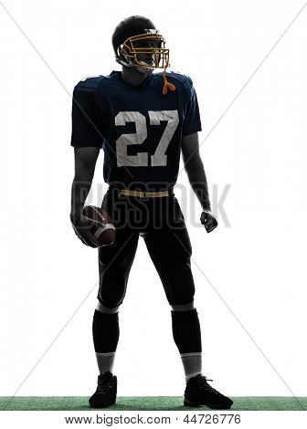 one caucasian quarterback american football player man standing in silhouette studio isolated on white background