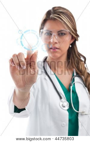 Young female surgeon touching digital screen. Isolated on white