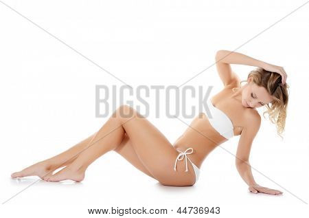 The girl in bikini isolated on white