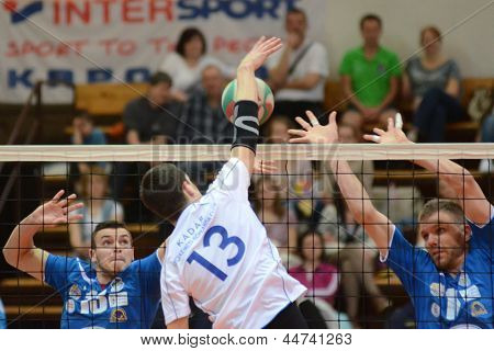 KAPOSVAR, HUNGARY - APRIL 15: Zoltan Kovacs (R) in action at a Hungarian National Championship volleyball game Kaposvar (blue) vs. Kecskemet (white), April 15, 2013 in Kaposvar, Hungary.