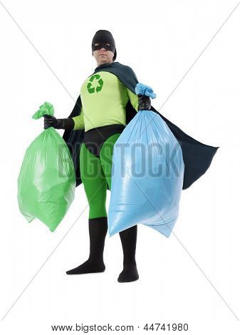 Eco superhero holding green and blue plastic bags full of domestic trash standing on white background - waste segregation concept