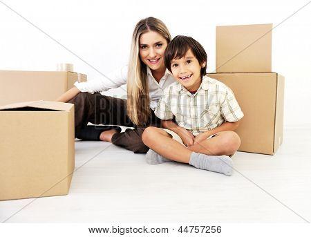 Beautiful woman and little child openig cardboard box