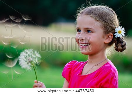 Summer joy - lovely girl blowing dandelion, happy child concept. Allergy season. poster