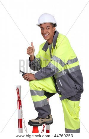 Roadworker in fluorescent jacket and trousers