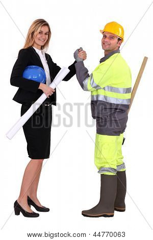 Engineer and a construction worker making a pact