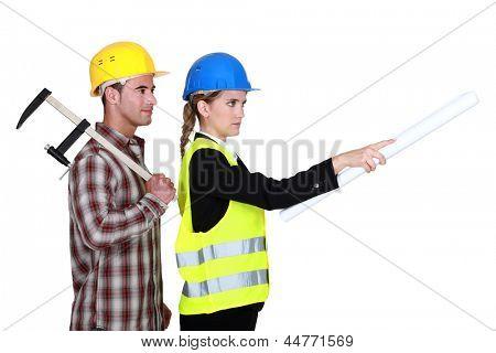 Tradesman following an engineer's orders