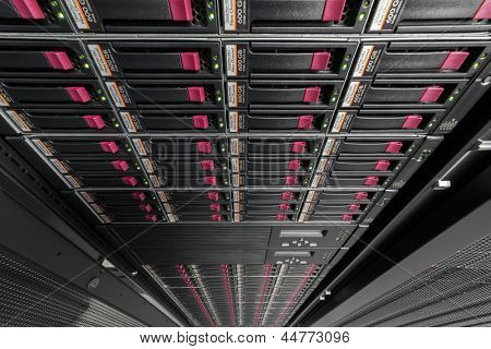 Big data serer in rack with multiple hard drives. poster