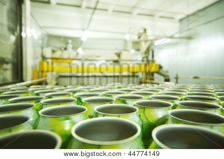 Lot of empty aluminum cans for drinks in light manufactory at large factory.