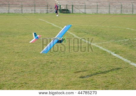 Flying radio controlled airplane