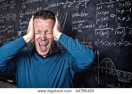 young caucasian desperate teacher portrait with blackboard