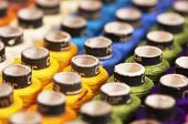 Reels of different colored threads. Yellow green blue purple white poster