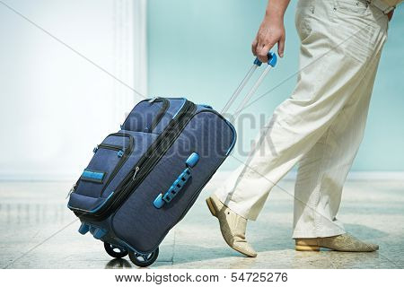 male passenger at the airport with laggage