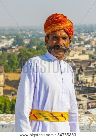 Rajasthani Man With Bright Red Turban And Bushy Mustache Poses For Tourists