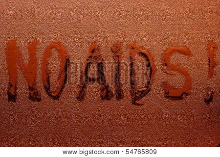 "The abstract inscription ""NO AIDS"" liquid on red rough skin poster"