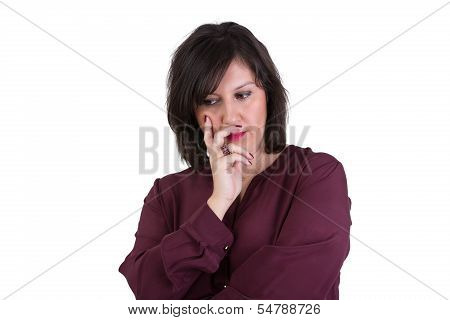 Middle Aged Businesswoman Looking Down Thoughtfully