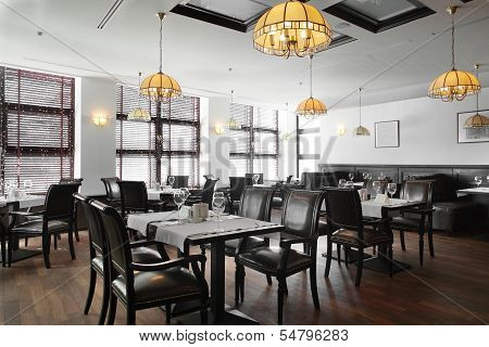 modern european restaurant with nice and bright interior poster