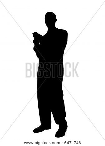 Man Standing Texting On Cell Phone Silhouette