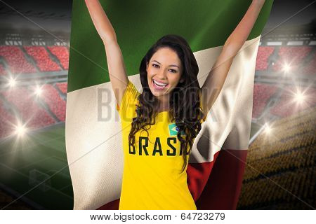 Excited football fan in brasil tshirt holding italy flag against vast football stadium with fans in yellow and red poster