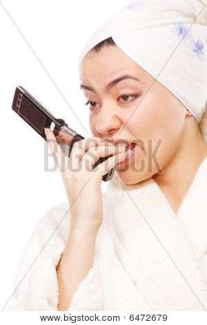 Expressive Woman In Bathrobe With Mobile