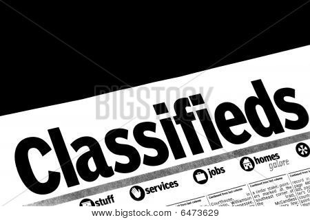 Classifieds Section Of Newspaper On Black Background