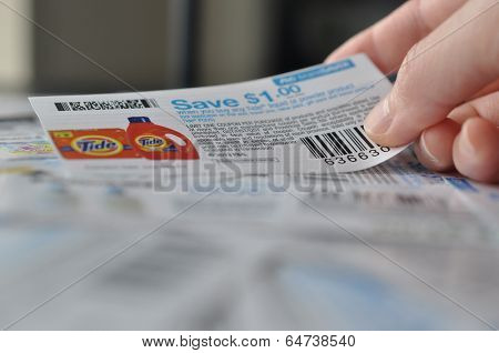 COQUITLAM, BC, CANADA - MAY 8 -  Coquitlam BC Canada - May 8, 2014 : Holding coupon for saving item. All coupons for Canadian store, they are issued by manufacturers of consumer packaged goods or by retailers in Canada.