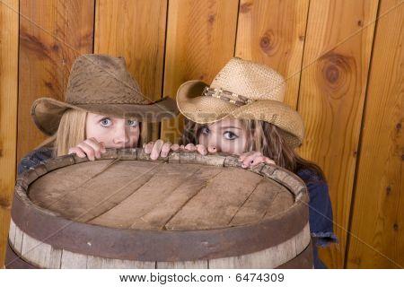 Girls Hiding Behind Barrel