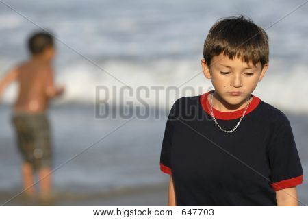 Boy Feeling Sad At The Beach