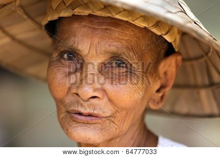 SIEM REAP, CAMBODIA, DECEMBER 04 : close portrait of an old Cambodian woman in a small and poor village near Siem Reap, Cambodia on December 04, 2012