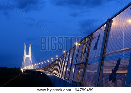 Highway Leads To Illuminated Bridge