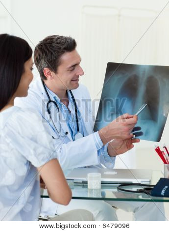 Doctors analyzing an x-ray in a meting poster