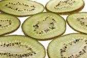 green kiwi slices pattern on white background; poster