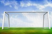 Digitally generated football pitch and goal under blue sky poster