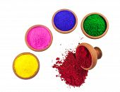 A variety of colored dyes in earthen bowls isolated on white. The red color is spilled. poster