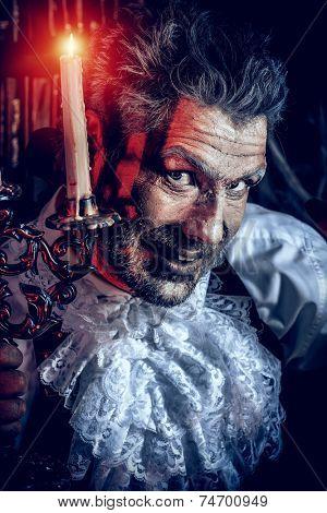 Crazy old man medieval scientist working in his laboratory. Alchemist. Halloween.