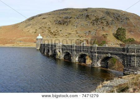 Craig Goch reservoir and dam arches Elan Valley Wales UK. poster