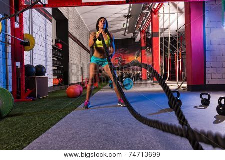battling ropes girl at gym workout exercise fitted body