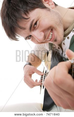 A handsome young man playing acoustic guitar poster
