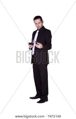 Businessman  With A Glass Of Drink Texting