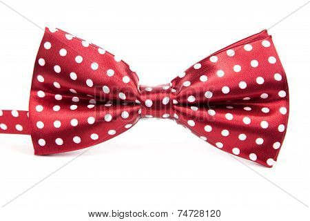 Elegant Red Bow Tie With White Polka Dots On An Isolated White Background
