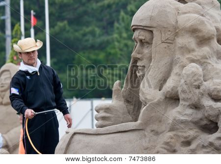 Sandsculpture artist working on his sculpture