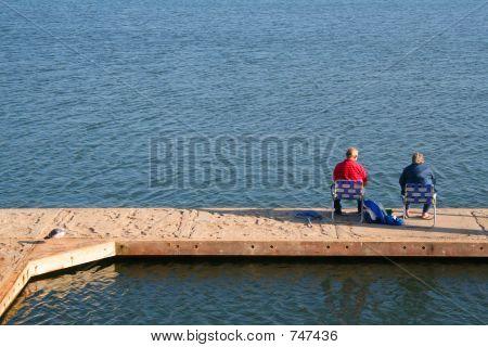Senior Couple Fishing on a Dock