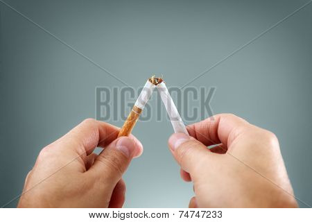 Breaking a cigarette in half concept for quitting smoking and healthy lifestyle
