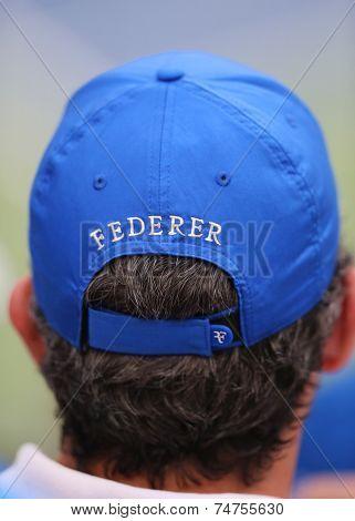 Tennis fan wears  Roger Federer hat during US Open 2014 semifinal match