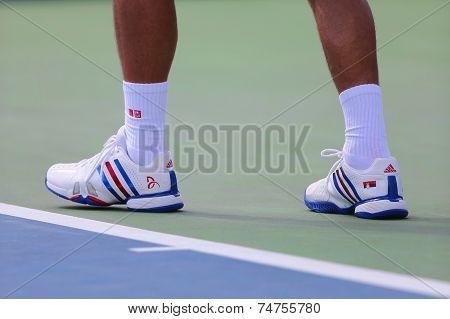 Six times Grand Slam champion Novak Djokovic wears custom Adidas tennis shoes during US Open match