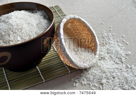 Rice in brown bowl and small basket
