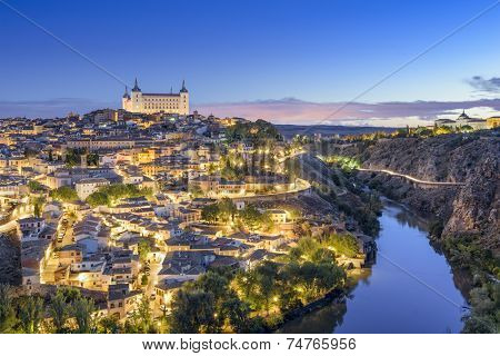Toledo, Spain town skyline on the Tagus River at dawn.