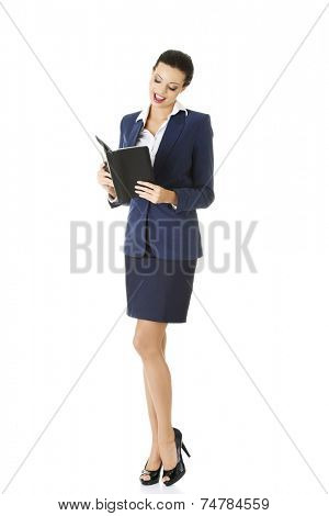 Young businesswoman reading a note