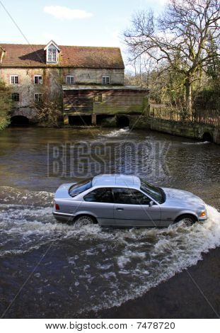 A car driving through a river ford