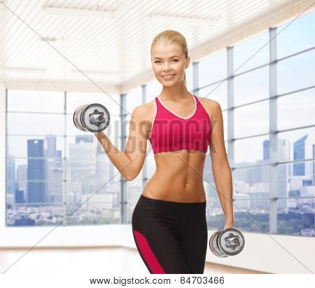 fitness, sport, fitness and people concept - smiling woman with dumbbells flexing biceps over gym or home background poster
